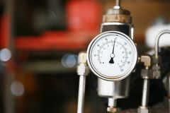 Pressure gauge using measure the pressure in production process. Worker or Operator monitoring oil and gas process by the gauge. For routine record and analysis stock images