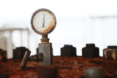 Pressure gauge using measure the pressure in production process. Worker or Operator monitoring oil and gas process by the gauge Stock Photo