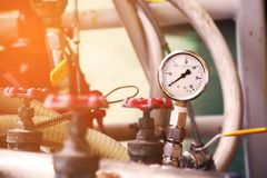 Pressure gauge using measure the pressure in production process. Worker or Operator monitoring oil and gas process by the gauge Royalty Free Stock Images