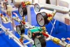 Pressure Gauge, Valves On Pipeline, Heat Circuit Stock Photos