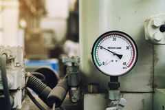 Pressure gauge was mounted on the old machine. Measuremant and equipment in the industry stock image