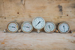 Pressure gauge with wood background. Stock Images