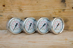 Pressure gauge with wood background. Stock Image