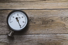 Pressure gauge on wood background. Top view Royalty Free Stock Photography