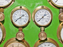 Pressure Gauges. Two pressure gauges from an old fashioned steam engine Royalty Free Stock Photo