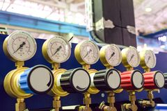 Pressure gauges with adjustment valves in industrial plant shop. Oxygen supply. Limited depth of field stock photo