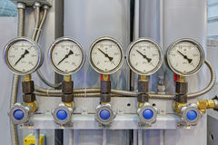 Pressure gauges. Five pressure gauges with liquid filling, close-up royalty free stock photo