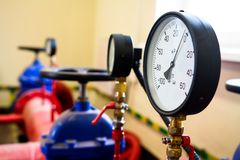 Pressure gauges on the industrial pipeline. Manometers on pipe valve of gas and oil plant royalty free stock photo
