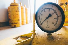 Pressure gauges and valves. Of chlorine gas cylinders Stock Photo