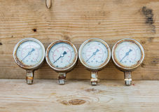 Pressure gauges on wood background stock photography