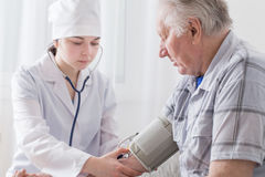 Pressure measurement in elderly men Stock Image