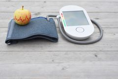 Pressure measuring device and apple royalty free stock photography