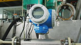 Pressure meter with screen on equipment in plant workshop