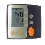 Pressure monitor. Digital blood pressure monitor isolated in white background Stock Photography