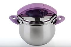 Pressure pan with Purple handles Stock Images