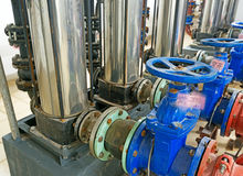 Pressure pump for running water Stock Images
