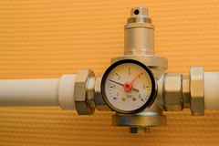 Pressure reducer with manometer. On polypropylene water pipe Royalty Free Stock Photography
