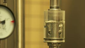 Pressure safety valve for brewery in action. Water gurgles and water bubbles stock footage