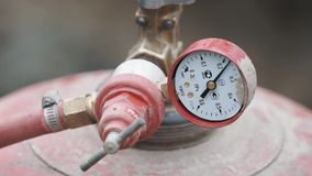 Pressure scale on crane part of red gas cylinder stock video