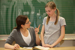 Pressure to perform at school. Pressure to perform - Teacher scolds student in the school Royalty Free Stock Photography