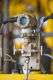 Pressure transmitter for monitor and sent measuring value to programmable logic controller PLC to control oil and gas process.  Royalty Free Stock Image