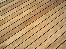 Pressure treated wood deck. Wooden deck, showcasing strips of pressure treated wood and wood grain Stock Photos