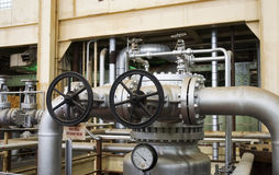 Pressure valve. A giant pressure valve in a decomissioned electrical power plant Stock Photos