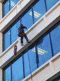 Pressure washing a building. Stock Photos