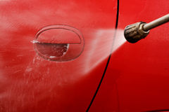 Pressure washing car Stock Photo