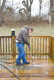 Pressure washing deck Royalty Free Stock Photos