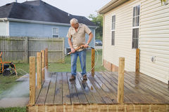 Pressure washing deck. Contractor pressure washing deck , getting home ready to sell Stock Images