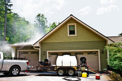 Pressure Washing a House Royalty Free Stock Image