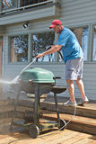 Pressure washing outdoor barbecue Royalty Free Stock Photo