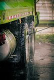 Pressure washing truck tires Stock Images