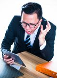 Pressured and serious. Businessman are pressured to work and unsuccessful Stock Image