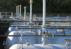 Pressurized tanks for the storage of methane gas. In an industrial refinery Royalty Free Stock Photos