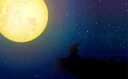 Prestando atenção à lua Imagens de Stock Royalty Free