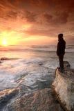 Prestando atenção ao por do sol Imagem de Stock