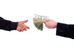 Prestare i soldi dei contanti Fotografia Stock