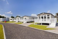 Six berth luxury static caravans with verandas, private parking Royalty Free Stock Images