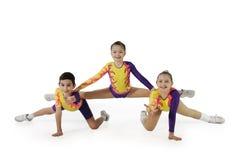 Prestazione dal giovane aerobics dell'atleta Immagine Stock Libera da Diritti