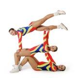 Prestazione dal giovane aerobics dell'atleta Fotografie Stock