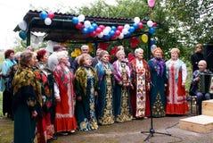 Prestazione del coro rurale Fotografia Stock