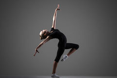 Prestazione della ragazza della ginnasta Fotografia Stock