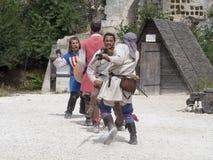 Prestazione teatrale di battaglia medievale in Les Baux-de-Provenza, Francia Immagini Stock