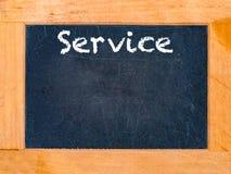 Preste serviços de manutenção à placa de giz Foto de Stock