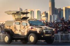 Presteer van militaire en burgerlijke voertuigen op Nationale de Dagparade Doha, Qatar van Qatar stock foto