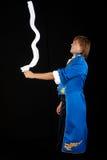 Prestidigitator no cauda-revestimento com lenço de pescoço. Foto de Stock