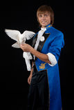Prestidigitator with white pigeon. Royalty Free Stock Image