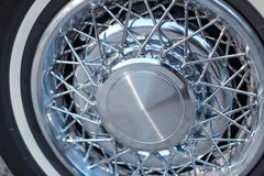 Prestige ally wheels on a vintage classic car. Prestige ally wheels with a spoke design on a vintage classic car in a close up view of the rim and hub Stock Images
